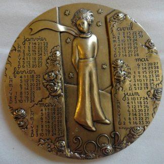 Médaille calendrier Le petit prince 2002
